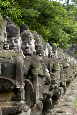 Statues of Devas, guardian gods, at the South Gate of Angkor Thom