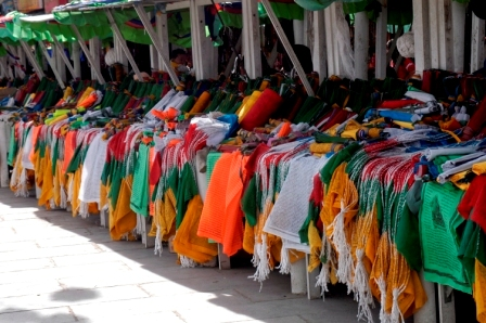 Stands selling prayer flags at flee market in Barkhor Square, Lhasa