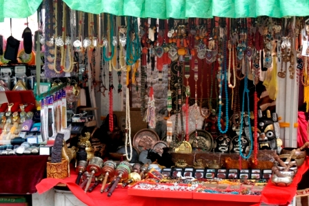 Stands selling prayer wheels, rosaries, necklaces and other objects at flee market in Barkhor Square
