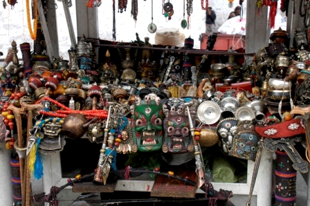 Masks stand at flee market in Barkhor Square