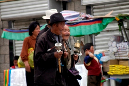 Tibetan man rotating his prayer wheel