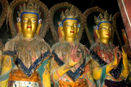 Three Buddha statues inside chapel in Gyantse Kumbum