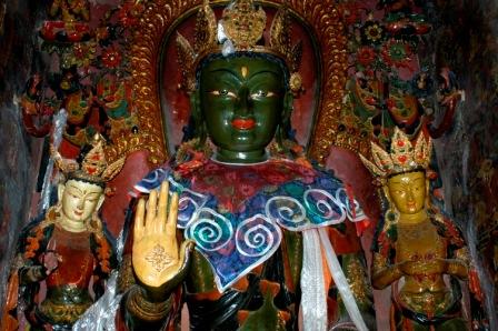 Green Buddha statue inside chapel in Gyantse Kumbum