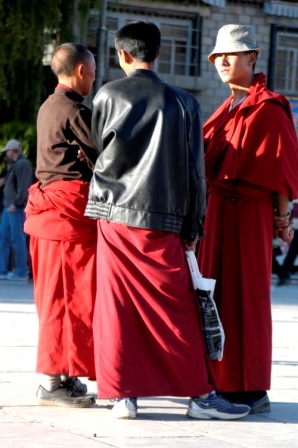Globalization... buddhist monk at Barkhor Squarewearing NIKE shoes and a leather jacket