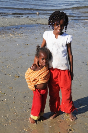 Ester and Sofia on the beach. Sofia is one of the last children to arrive at Anidan